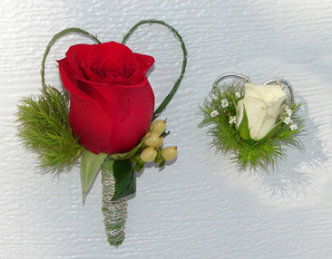 Red and white rose boutonnieres