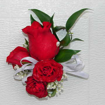 Barb's red rose corsage