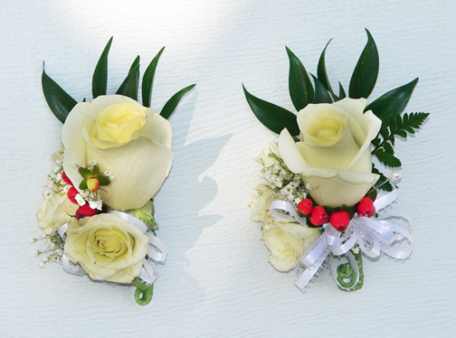 Candice's white rose corsages